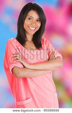 Happy tanned woman looking at the camera