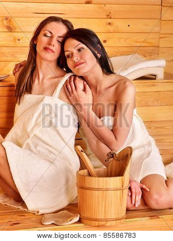 Young two happy woman in sauna.