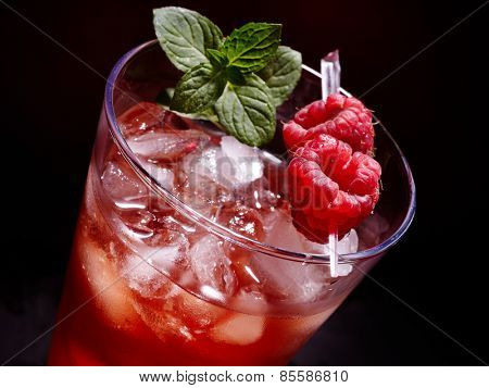 Cold red drink  with raspberry and mint leaf. Top view.