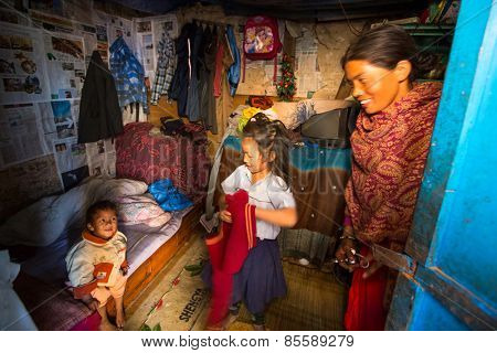 KATHMANDU, NEPAL - CIRCA DEC, 2013: Unidentified local people in a house in a poor area of the city. The caste system is still intact today but the rules are not as rigid as they were in the past.