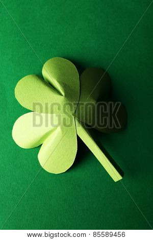 Shamrock leaf on green background