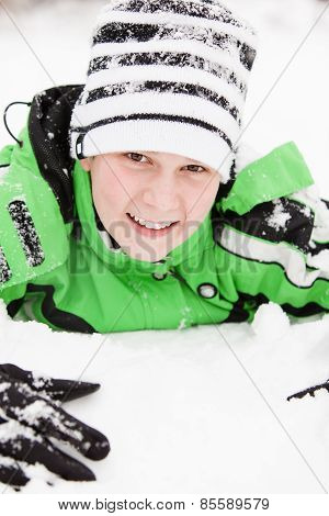Friendly Young Boy Playing In Winter Snow