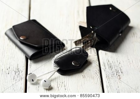 Hand made leather man accessories on white wooden background