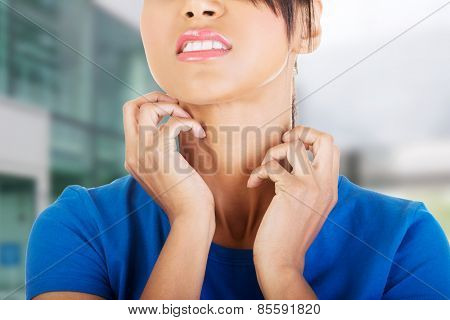 Young beautiful woman scratching her self