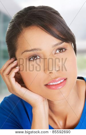 Beautiful woman's face in a closeup while thinking