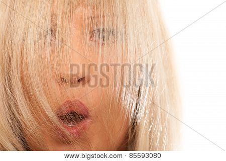 Woman Covering Her Surprised Face With Long Straight Hair.