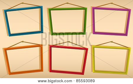 Six wooden frames hanging on the wall