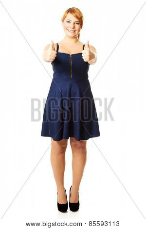 Happy overweight woman with thumbs up.