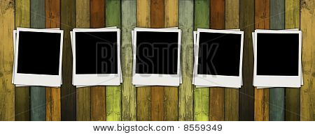 Blank Photos on Wooden Wall
