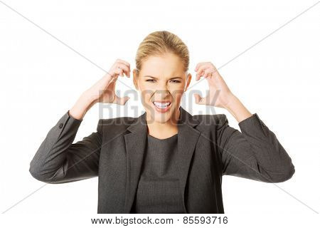 Angry businesswoman pulling her head.