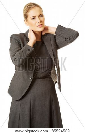 Businesswoman having huge neck pain
