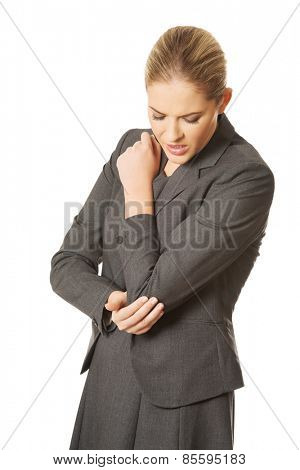 Beautiful woman with elbow pain