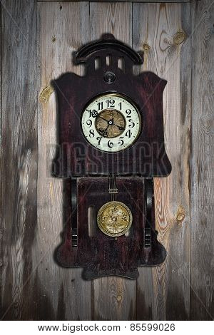 antique clock on a wooden wall
