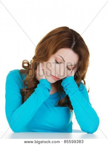 Portrait of depressed woman touching her head.
