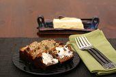 image of fresh slice bread  - Freshly baked and sliced banana bread with butter - JPG