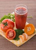 pic of celery  - Mixing of celery and tomato into a healthy smoothies for detox - JPG