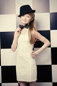 image of black tie  - Elegant teen girl wearing white dress - JPG