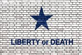 picture of revolutionary war  - slogan Liberty or Death on a brick wall - JPG