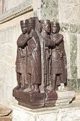 image of porphyry  - A porphyry statue of the first Roman Tetrarchy stolen from Constantinople during the Fourth Crusade and now embedded in an external wall of the Basilica di San Marco Venice Italy - JPG