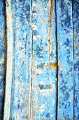 stock photo of nail paint  - blue stripped paint in the wood door and rusty nail - JPG