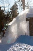 picture of snow clouds  - a cloud of snow from a snow mowing tractor - JPG