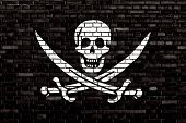 pic of pirate flag  - a Pirate flag painted on brick wall - JPG