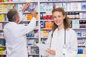 foto of pharmaceutical  - Pharmacists searching medicines with prescription at hospital pharmacy - JPG