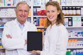 pic of hospital  - Pharmacist showing tablet pc at hospital pharmacy - JPG