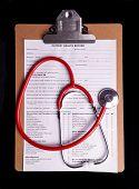 image of medical chart  - Medical Chart and stethoscope isolated on black background - JPG