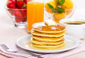 pic of maple syrup  - Pancakes with maple syrup and butter on the table - JPG