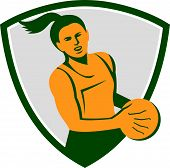 picture of netball  - Illustration of a netball player holding ball viewed from front set inside shield crest on isolated white background done in retro style - JPG