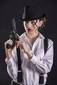 stock photo of gangster  - Beautiful and dangerous - JPG