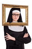 stock photo of nun  - Young nun with frame isolated on white - JPG