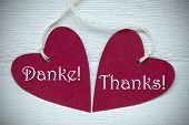 picture of thankful  - Two Red Hearts Label Or Tag With White Ribbon On White Wooden Background With German Text Danke Means Thank You And English Text Thanks Vintage Retro Or Rustic Style With Frame - JPG