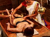 picture of ayurveda  - Young woman having stomach Ayurveda spa treatment - JPG