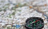 picture of compasses  - The magnetic compass is located on a topographic map - JPG