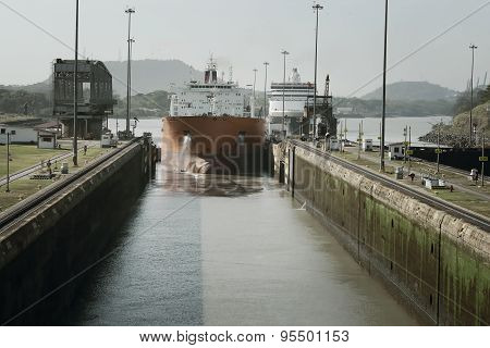 Large cargo ship entering Miraflores Locks at Panama Canal, Panama