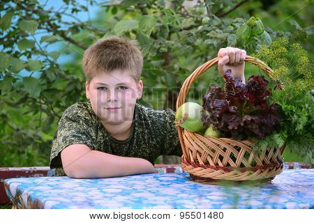Teen Boy With  Basket Of Fresh Vegetables In The Garden