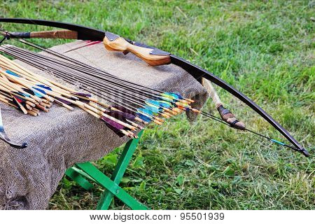 Bow And Arrows On Small Table.