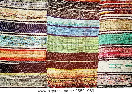 Multicolored Handmade Rugs As Abstract Background.