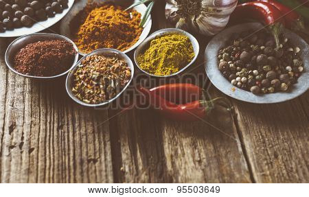 Cooking ingredients, spice on old wooden background.