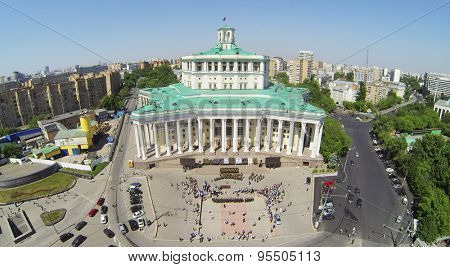 RUSSIA, MOSCOW - MAY 20, 2014: Many people watch military orchestra which performs near Central Academic Theatre of Russian Army at sunny spring day. Aerial view