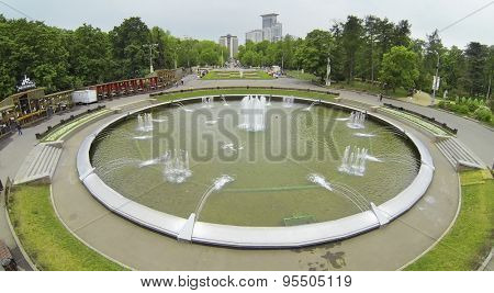 RUSSIA, MOSCOW - MAY 17, 2014: Fountain on square with people in park Sokolniki. Aerial view.