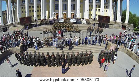 RUSSIA, MOSCOW -?? 20 MAY, 2014: Lot of people watch performance with military orchestra near Central Academic Theatre of Russian Army at sunny spring day. Aerial view