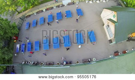 RUSSIA, MOSCOW - MAY 17, 2014: Many people play table tennis in park Sokolniki at spring day. Aerial view
