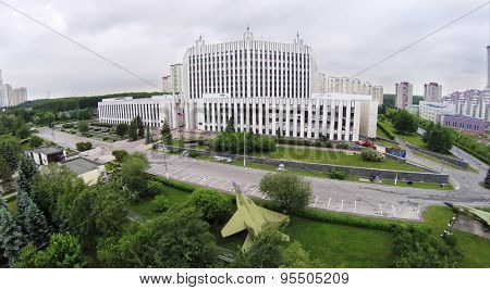 RUSSIA, MOSCOW - MAY 28, 2014: Tanks and fighters near edifice of Military Academy of General Staff of Armed Forces of Russian Federation at spring cloudy day. Aerial view