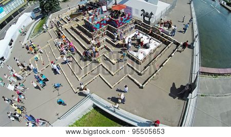 RUSSIA, MOSCOW - 24 MAY, 2014: People walk in labyrinth of books on territory of All Russia Exhibition Center. Aerial view
