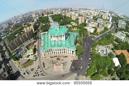RUSSIA, MOSCOW - MAY 20, 2014: Cityscape with performance of military orchestra near of Central Academic Theatre of Russian Army at sunny spring day. Aerial view