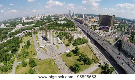 RUSSIA, MOSCOW - MAY 24, 2014: Megalopolis panorama with Obelisk Conquerors of Space, hotel Cosmos, ferris wheel at Russian Exhibition Complex at sunny spring day. Aerial view