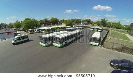 RUSSIA, MOSCOW - MAY 23, 2014: City buses parking on street with traffic at spring sunny day. Aerial view